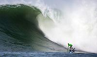 "Half Moon Bay, California - January 24, 2014: 2014 Maverick's Invitational Grant ""Twiggy"" Baker cheers on good friend Shawn Dollar pointing down the line."