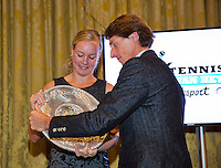 December 08, 2014, Amsterdam, Amstel Hotel, Tennisser off the Year Awards, Kiki Bertens receives the Betty Stove award from the hands of Paul Haarhuis.<br /> Photo: Henk Koster
