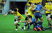 Hurricanes' Ardie Savea is scragged during the Super Rugby Aotearoa match between the Hurricanes and Blues at Sky Stadium in Wellington, New Zealand on Saturday, 18 July 2020. Photo: Dave Lintott / lintottphoto.co.nz