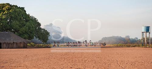 Xingu Indigenous Park, Mato Grosso, Brazil. Aldeia Matipu. Visiting tribe arriving for the Kuarup.