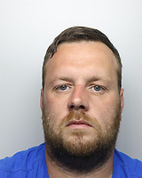 Pictured: Police custody picture of Christopher Morris<br />