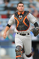 Delmarva Shorebirds catcher Austin Wynns #12 during a game against the  Asheville Tourists at McCormick Field on April 5, 2014 in Asheville, North Carolina. The Tourists defeated the Shorebirds 5-3. (Tony Farlow/Four Seam Images)