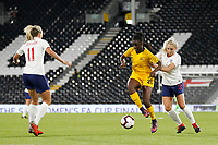 Princess Ibini-isei of Australia Women holds off Alex Greenwood of England Women during the Women's international friendly match between England Women and Australia at Craven Cottage, London, England on 9 October 2018. Photo by Carlton Myrie / PRiME Media Images.