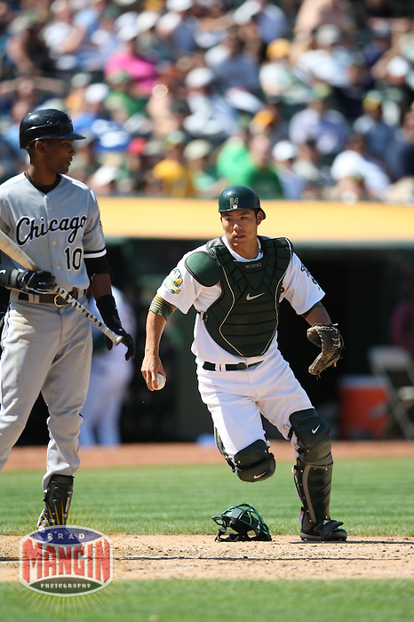 OAKLAND, CA - AUGUST 16:  Catcher Kurt Suzuki of the Oakland Athletics, right, tags out Chicago White Sox batter Alexei Ramirez at home plate during their game at the McAfee Coliseum in Oakland, California on August 16, 2008.  The White Sox defeated the Athletics 2-1.  Photo by Brad Mangin