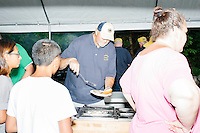 Members of the Londonderry Lions Club serve food at Londonderry Old Home Day in Londonderry, New Hampshire. Republican presidential candidate Dr. Ben Carson later showed up at the event to meet New Hampshire voters.