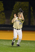 Wake Forest Demon Deacons right fielder Jack Carey (20) catches a fly ball during the game against the North Carolina State Wolfpack at Wake Forest Baseball Park on March 15, 2013 in Winston-Salem, North Carolina.  The Wolfpack defeated the Demon Deacons 12-6.  (Brian Westerholt/Four Seam Images)