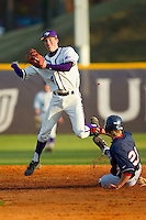 Kyle Brandenburg (4) of the High Point Panthers attempts to turn a double play against the Liberty Flames at Willard Stadium on March 23, 2013 in High Point, North Carolina.  The Panthers defeated the Flames 9-3.  (Brian Westerholt/Four Seam Images)
