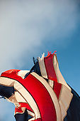 England. Ragged, tattered, torn flying Union Jack.