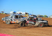 Apr 17, 2011; Surprise, AZ USA; LOORRS driver Austin Kimbrell (88) flips off Ryan Beat (51) as they spin during round 4 at Speedworld Off Road Park. Mandatory Credit: Mark J. Rebilas-