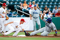 Ryan Jackson (23) of the Springfield Cardinals tags Wilin Rosario (20) of the Tulsa Drillers during a game against the Tulsa Drillers at Hammons Field on July 18, 2011 in Springfield, Missouri. Rosario was called safe on the play. Tulsa defeated Springfield 13-8. (David Welker / Four Seam Images)