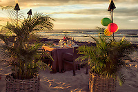 Dinner table set at beach side of the Four Seasons. Hawaii, the big island