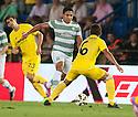 Celtic's Emilio Izaguirre takes on Dos Santos.