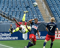 FOXBOROUGH, MA - MAY 12: Elma Nfor #15 of Union Omaha bicycle kick past Francois Dulysse #60 of New England Revolution II during a game between Union Omaha and New England Revolution II at Gillette Stadium on May 12, 2021 in Foxborough, Massachusetts.