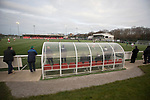 Spartans 1 University of Stirling 0, 12/03/2016. Ainslie Park, Scottish Lowland League. Spectators watching the action next to the dugout at the Spartans versus University of Stirling Scottish Lowland League match at Ainslie Park, Edinburgh. The match was one of six attended by members of GroundhopUK over the weekend to accommodate groundhoppers, fans who attempt to visit as many football venues as possible. Around 100 fans in two coaches from England participated in the 2016 Lowland League Groundhop and they were joined by other individuals from across the UK which helped boost crowds at the six featured matches. Photo by Colin McPherson