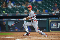 Marco Ramos (22) of the Louisiana Ragin' Cajuns follows through on his swing against the Kentucky Wildcats in game seven of the 2018 Shriners Hospitals for Children College Classic at Minute Maid Park on March 4, 2018 in Houston, Texas.  The Wildcats defeated the Ragin' Cajuns 10-4. (Brian Westerholt/Four Seam Images)