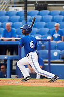 Dunedin Blue Jays center fielder D.J. Davis (6) follows through on a swing during a game against the Bradenton Marauders on July 17, 2017 at Florida Auto Exchange Stadium in Dunedin, Florida.  Bradenton defeated Dunedin 7-5.  (Mike Janes/Four Seam Images)