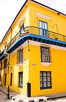 Colorful yellow building in Old Havana in Havana Cuba Habana