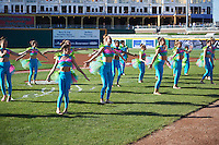 Dancers perform before a Lansing Lugnuts  game against the Peoria Chiefs on June 6, 2015 at Cooley Law School Stadium in Lansing, Michigan.  Lansing defeated Peoria 6-2.  (Mike Janes/Four Seam Images)
