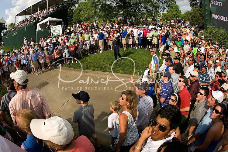 PGA golfer Phil Mickelson hits from a crowd of spectators during the 2008 Wachovia Championships at Quail Hollow Country Club in Charlotte, NC.