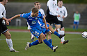 Queen of the South's Gavin Reilly scores their second goal ...