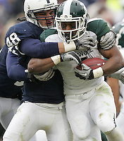 State College, PA - 11/27/2010:  LB Chris Colasanti (48) tackles MSU ballcarrier Edwin Baker (4).  Colasanti had 10 total tackles during the game, while Baker rushed 28 times for 128 yards and one touchdown.  Penn State lost to Michigan State by a score of 28-22 on Senior Day at Beaver Stadium...Photo:  Joe Rokita / JoeRokita.com..Photo ©2010 Joe Rokita Photography