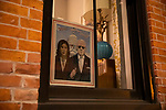 A portrait of Joe Biden and Kamala Harris is displayed in a window as demonstrators march during a protest demanding every vote cast be counted in the 2020 presidential election between U.S. President Donald Trump and former Vice President Joe Biden on November 4, 2020 in New York City.  Photograph by Michael Nagle