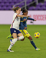 ORLANDO, FL - JANUARY 22: Tierna Davidson #12 battles Kena Romero #9 for the ball during a game between Colombia and USWNT at Exploria stadium on January 22, 2021 in Orlando, Florida.