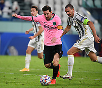 Football Soccer: UEFA Champions League -Group Stage-  Group G - Juventus vs FC Barcellona, Allianz Stadium. Turin, Italy, October 28, 2020.<br /> Barcellona's captain Lionel Messi (l) in action with Juventus' captain Leonardo Bonucci (r) during the Uefa Champions League football soccer match between Juventus and Barcellona at Allianz Stadium in Turin, October 28, 2020.<br /> UPDATE IMAGES PRESS/Isabella Bonotto