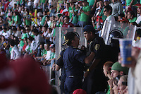 Mexican police officers in riot gear talk as they  separate the USA and Mexico fans at Azteca stadium. The United States Men's National Team played Mexico in a CONCACAF World Cup Qualifier match at Azteca Stadium in, Mexico City, Mexico on Wednesday, August 12, 2009.