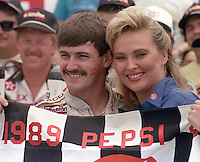 Davey Allison 1st place winner beauty queen checkered flag victory lane celebrates Pepsi 400 at Daytona International Speedway in Daytona beach, FL on July 1, 1989. (Photo by Brian Cleary/www.bcpix.com)