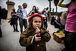 An Jewish boy dressed as a soldier eats candies, as Jewish settlers celebrate the Purim holiday in a parade at the West Bank city of Hebron Sunday March 12 2017. Purim is a Jewish holiday that commemorates the saving of the Jewish people in ancient Persia , the story is recorded in the Biblical Book of Esther. Photo by Eyal Warshavsky