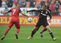Washington, D.C.- March 29, 2014. Fabian Espindola (9) of D.C. United  goes against Alex of the Chicago Fire.  The Chicago Fire tied D.C. United 2-2 during a Major League Soccer Match for the 2014 season at RFK Stadium.