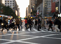 AVAILABLE FROM GETTY IMAGES FOR COMMERCIAL AND EDITORIAL LICENSING.   Please go to www.gettyimages.com and search for image # 135369276.<br /> <br /> Busy, Blurred Motion View of Commuters Crossing Street in Midtown Manhattan During the Evening Rush Hour, New York City, New York State, USA