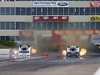 May 21, 2016; Topeka, KS, USA; NHRA funny car driver Jack Wyatt (left) alongside Brian Stewart during qualifying for the Kansas Nationals at Heartland Park Topeka. Mandatory Credit: Mark J. Rebilas-USA TODAY Sports