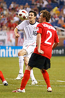 7 June 2011: USA Men's National Team midfielder Sacha Kljestan (16) takes a shot as Canada midfielder Nikolas Ledgerwood (2) defend during the CONCACAF soccer match between USA MNT and Canada MNT at Ford Field Detroit, Michigan. USA won 2-0.