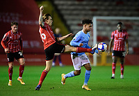 Lincoln City's Harry Anderson vies for possession with Manchester City U21's Oscar Bobb<br /> <br /> Photographer Chris Vaughan/CameraSport<br /> <br /> EFL Papa John's Trophy - Northern Section - Group E - Lincoln City v Manchester City U21 - Tuesday 17th November 2020 - LNER Stadium - Lincoln<br />  <br /> World Copyright © 2020 CameraSport. All rights reserved. 43 Linden Ave. Countesthorpe. Leicester. England. LE8 5PG - Tel: +44 (0) 116 277 4147 - admin@camerasport.com - www.camerasport.com