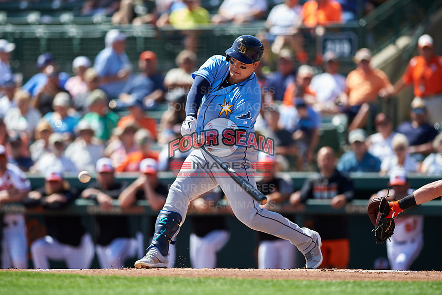 Tampa Bay Rays first baseman Ji-Man Choi (26) swings at a pitch during a Grapefruit League Spring Training game against the Baltimore Orioles on March 1, 2019 at Ed Smith Stadium in Sarasota, Florida.  Rays defeated the Orioles 10-5.  (Mike Janes/Four Seam Images)