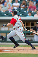 Jordan Lennerton (32) of the Gwinnett Braves follows through on his swing against the Charlotte Knights at BB&T BallPark on August 11, 2015 in Charlotte, North Carolina.  The Knights defeated the Braves 3-2.  (Brian Westerholt/Four Seam Images)