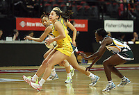 Australia's Madison Browne looks to pass the ball against South Africa in the New World Quad series netball match, TSB Bank Arena, Wellington, New Zealand, Thursday, October 25, 2012. Credit:NINZ / Dianne Manson.