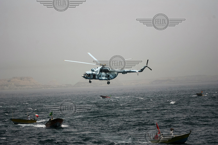 Military fast boats and helicopters from Iran's elite Revolutionary Guards during manoeuvres off Larak Island in the Persian (Arabian) Gulf.