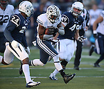Nevada defenders Charles Garrett, left, and Jordan Dobrich chase a BYU running back during an NCAA college football game in Reno, Nev., on Saturday, Nov. 30, 2013. (AP Photo/Cathleen Allison)