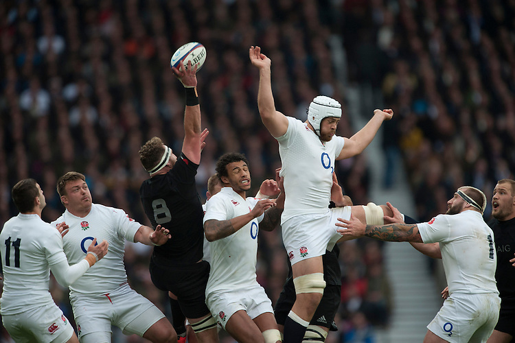 Kieran Read of New Zealand collects the ball as Dave Attwood of England attempts to challenge during the QBE International match between England and New Zealand at Twickenham Stadium on Saturday 8th November 2014 (Photo by Rob Munro)