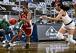SIOUX FALLS, SD - MARCH 7: Uju Ezeudu #24 of the Denver Pioneers drives to the basket past Ryan Cobbins #5 of the North Dakota State Bison during the Summit League Basketball Tournament at the Sanford Pentagon in Sioux Falls, SD. (Photo by Dave Eggen/Inertia)