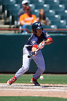 Reading Fightin Phils second baseman KC Serna (5) lays down a bunt during a game against the Bowie Baysox on July 22, 2015 at Prince George's Stadium in Bowie, Maryland.  Bowie defeated Reading 6-4.  (Mike Janes/Four Seam Images)