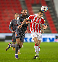 29th December 2020; Bet365 Stadium, Stoke, Staffordshire, England; English Football League Championship Football, Stoke City versus Nottingham Forest; James Chester of Stoke City heads the ball back