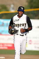 Missoula Osprey outfielder Roberto Rodriguez during a game vs. the Idaho Falls Chunkars at Ogren Park at Allegiance Field in Missoula, Montana, on August 16, 2010. Photo By Robert Gurganus/Four Seam Images