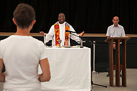 Switzerland. Canton Ticino. Tenero. Camping Campofelice. Don Matias Nicolau Hungulu is a catholic priest from Angola (Africa). He is celebrating the holy mass on Sunday in the Pavillion. 22.07.2018 © 2018 Didier Ruef