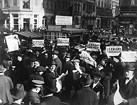 Peace rumor, New York.  Crowd at Times Square holding up Extras telling about the signing of the Armistice.  The Government report that the news was not true did not stop the celebration.  November 7, 1918.  Western Newspaper Union. (War Dept.)<br />NARA FILE #:  165-WW-77C-17<br />WAR & CONFLICT BOOK #:  710