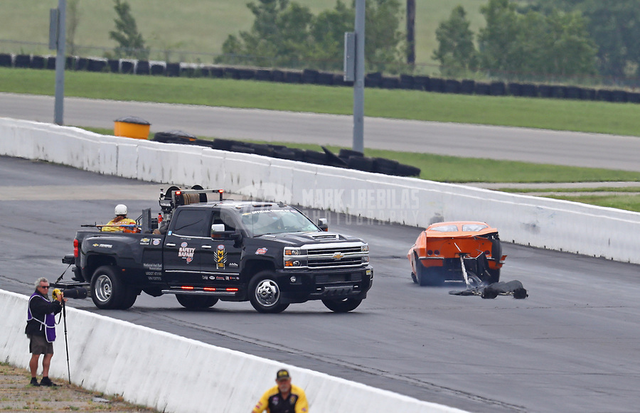 Jun 9, 2019; Topeka, KS, USA; The Safety Safari arrives after NHRA pro mod driver Jeremy Ray crashes during the Heartland Nationals at Heartland Motorsports Park. Ray would be transported to a local hospital for evaluation. Mandatory Credit: Mark J. Rebilas-USA TODAY Sports