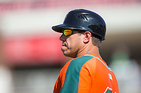 Greensboro Grasshoppers manager Kevin Randel (25) coaches third base during the game against the Kannapolis Intimidators at Intimidators Stadium on July 17, 2016 in Greensboro, North Carolina.  The Intimidators defeated the Grasshoppers 3-2 in game one of a double-header.  (Brian Westerholt/Four Seam Images)
